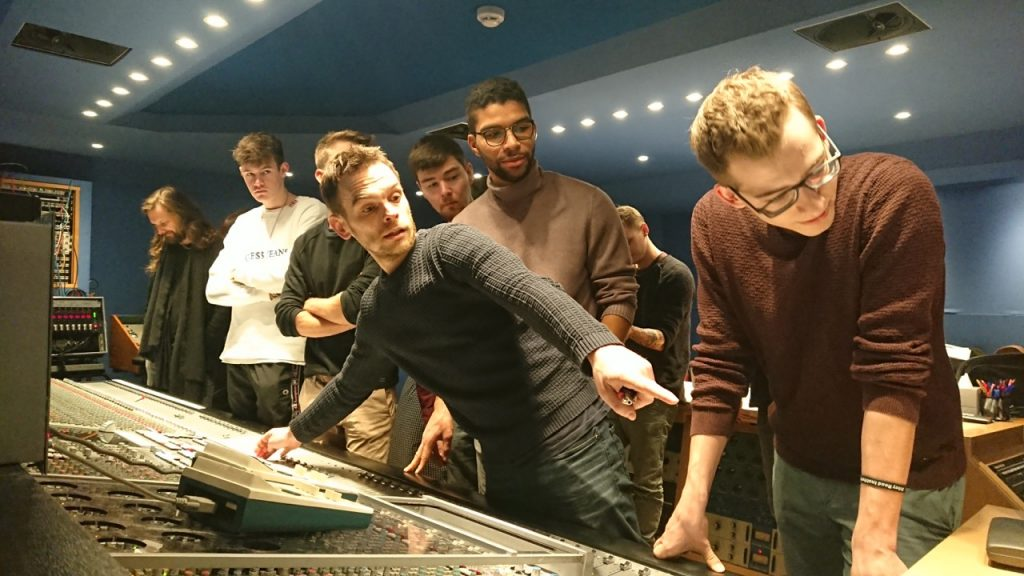 Stefano Civetta and the graduates behind the SSL desk in Studio 3